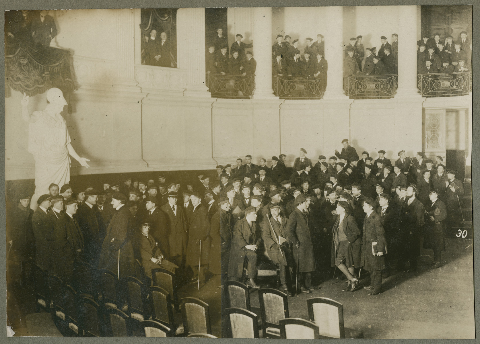 Students at the von Bissing University in Gent gather  in the central auditorium of the Aula on Vorderstraat.
