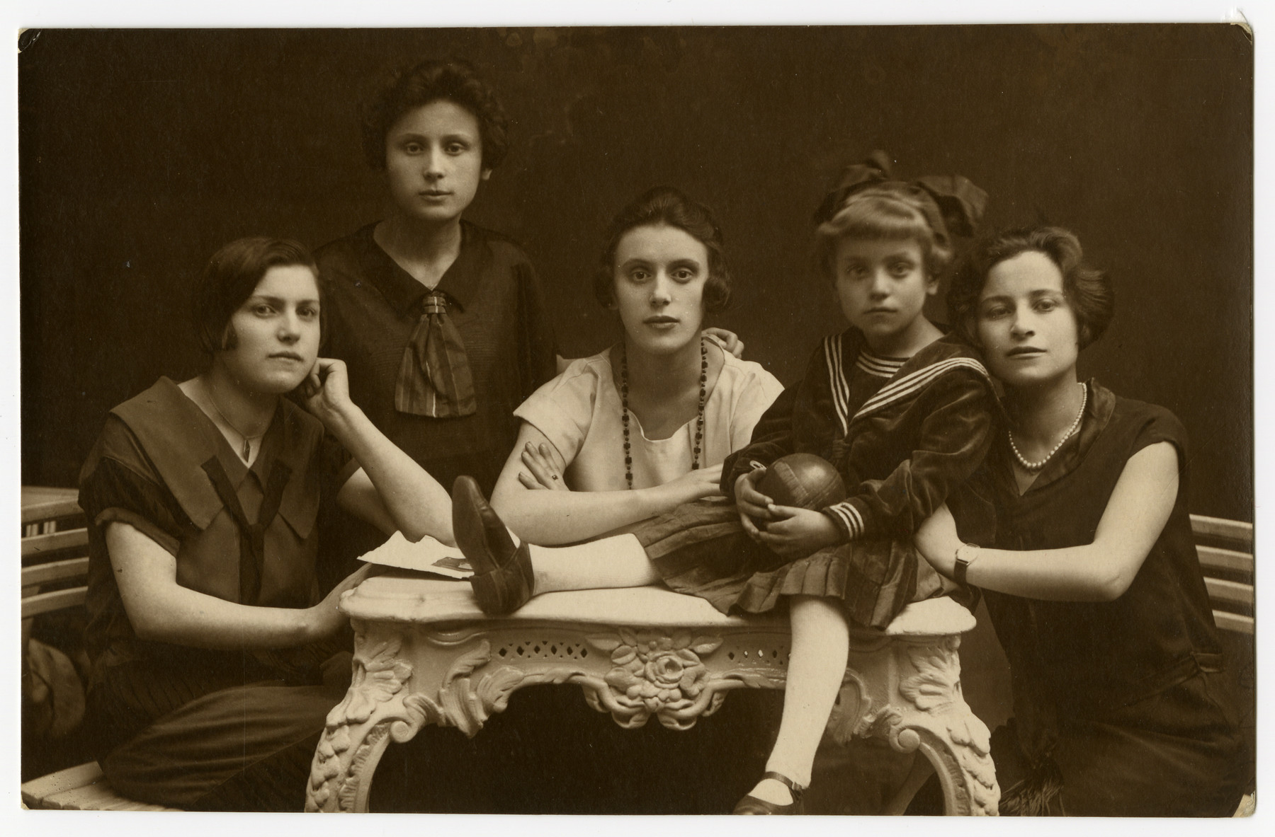 Studio portrait of five Polish Jewish children and teenagers.  Feiga Grosman is pictured on the left and Ruszka Grosman is pictured second from the right.