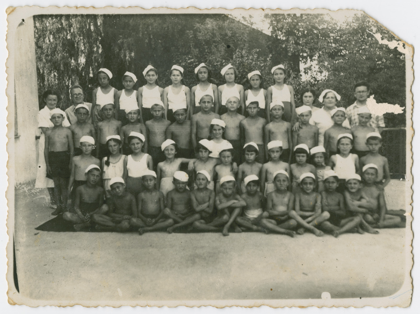 "Group portrait of children in a T.O.Z. summer camp in the summer of 1940,   Bella Preskovsky attended the. summer camp in Bialystok and was treated there as a ""celebrity"" from Palestine. Many of the children depicted in the photograph were deported from the Bialystok ghetto to Theresienstadt in 1943."