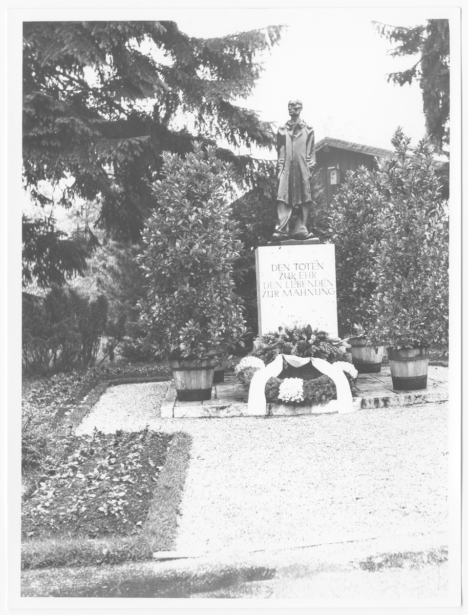 Postwar view of a statue in the Dachau concentration camp memorializing those who perished.