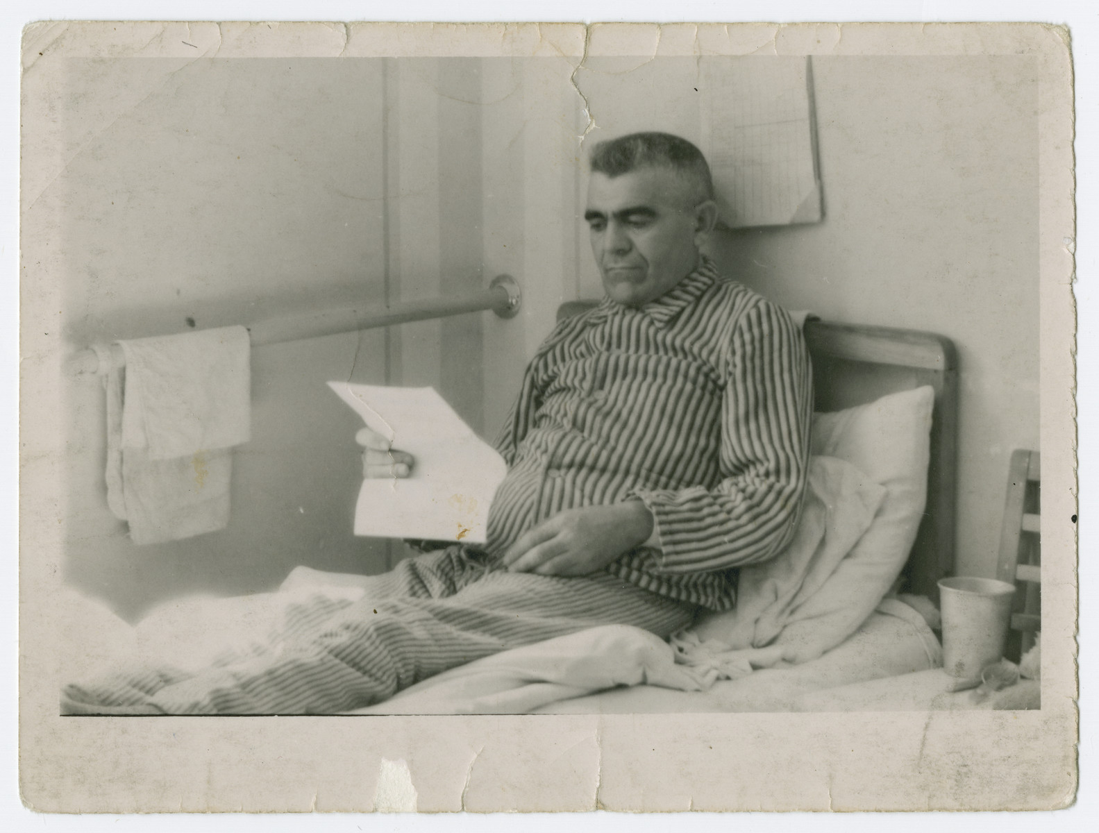 Jozef Rakowski recuperates in his hospital bed following liberation from Mauthausen.