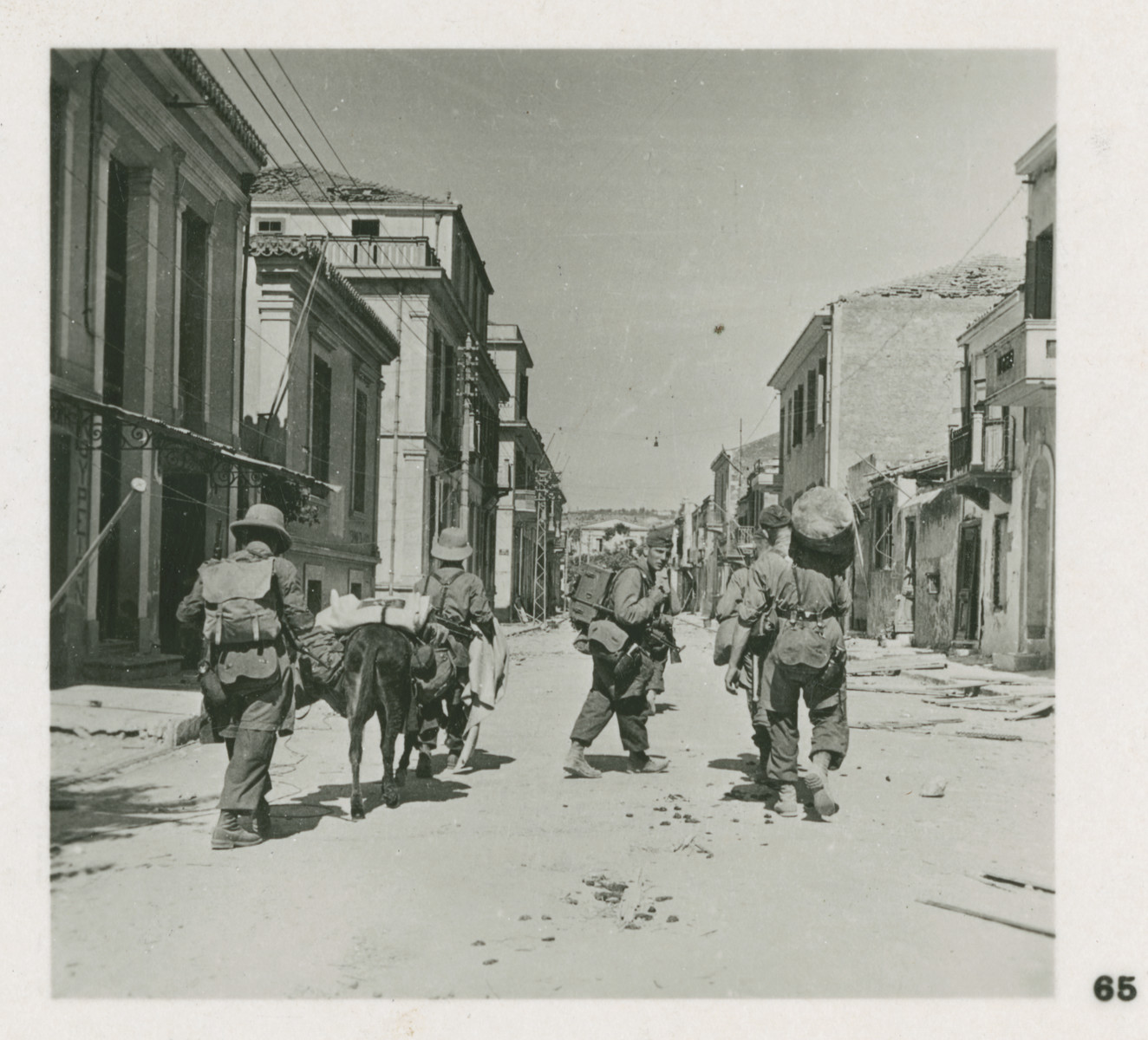 One side of a stereograph of Nazi paratroopers invading Chania, Crete.  Original caption in German reads: Fallschirmjäger in den Strassen der kretischen Hauptstadt Chanea unmittelbar nach deren Einnahme