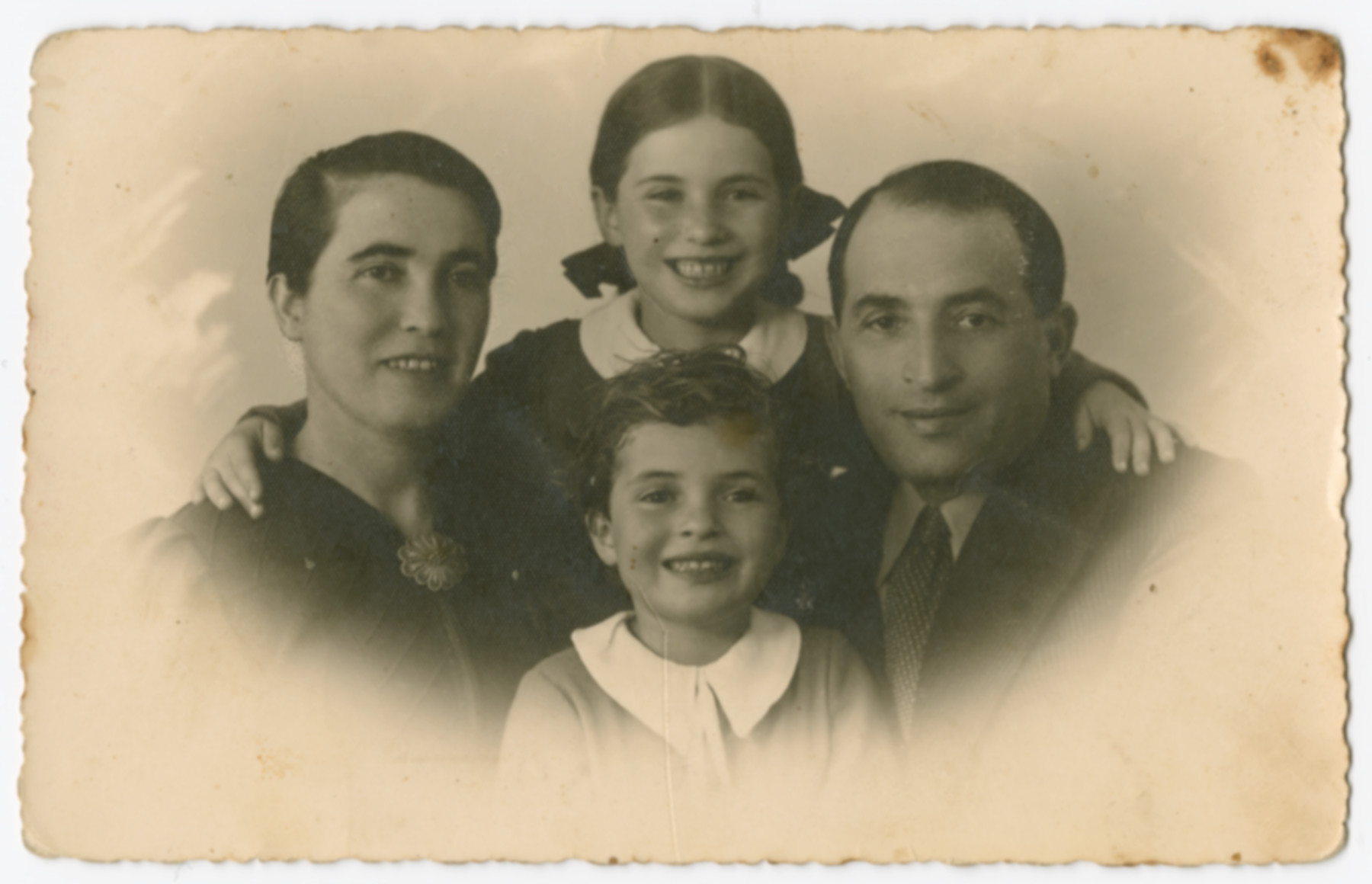 Studio portrait of the Preskowski family in Palestine.  Pictured are Chana, Jacob, Bella and Lea.