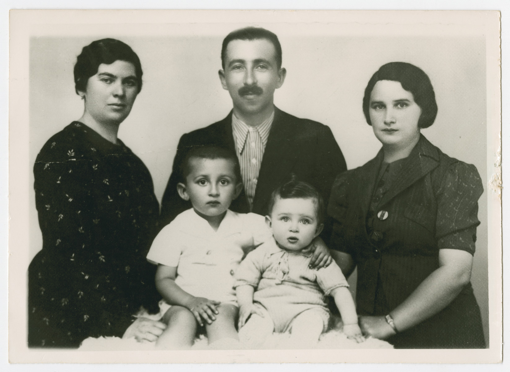 Sandor and Ilona Seidenfeld pose with Ilona's step-mother Yudel (far left)  and their sons Ezra and Mordche.