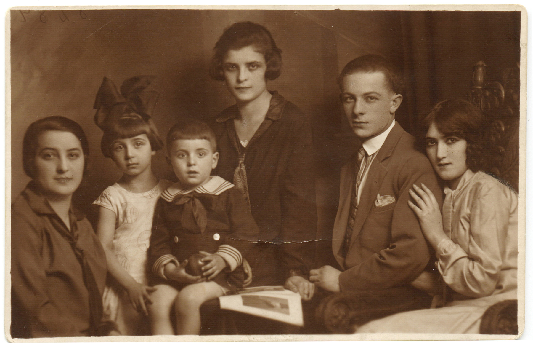Studio portrait of a prewar Jewish family in Lodz, Poland.  Pictured on the far right is Helena Bilander Kellner and her husband.