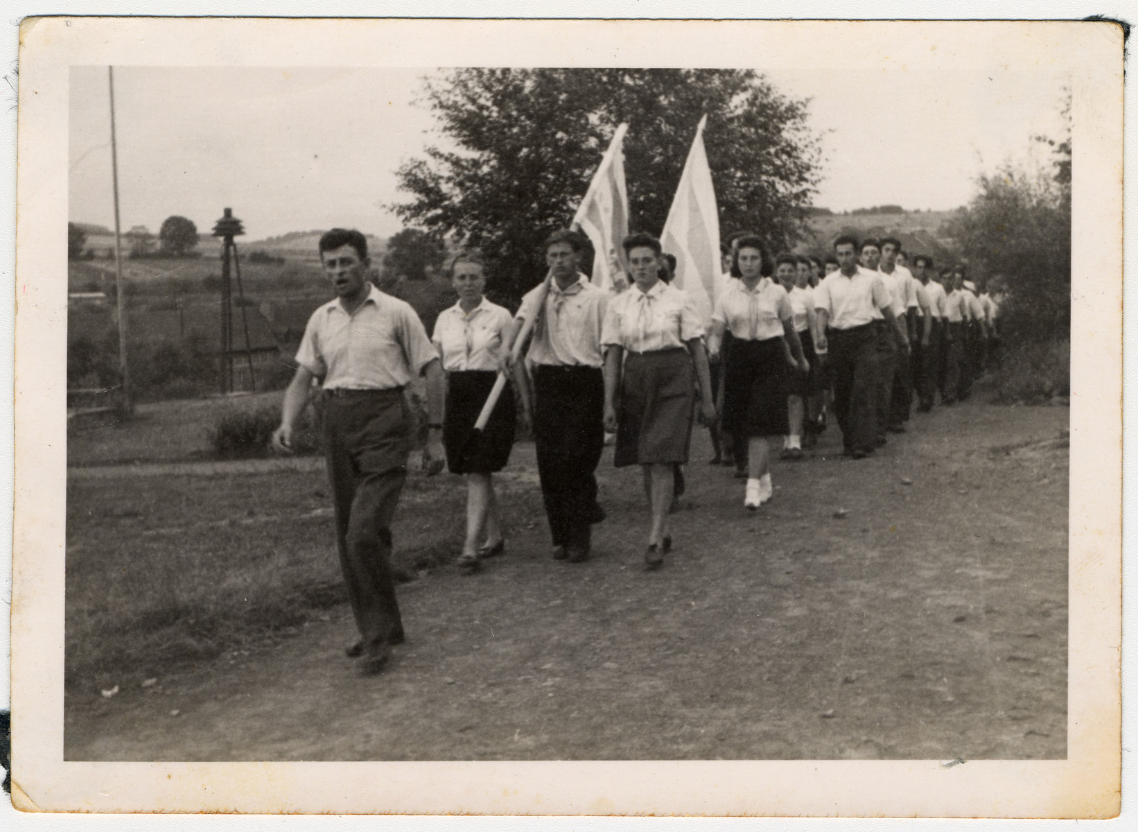 Jewish displaced person's march with a flag in a Zionist demonstration in Hessisch-Lichtenau.  Among those pictured is Sara Wiener.