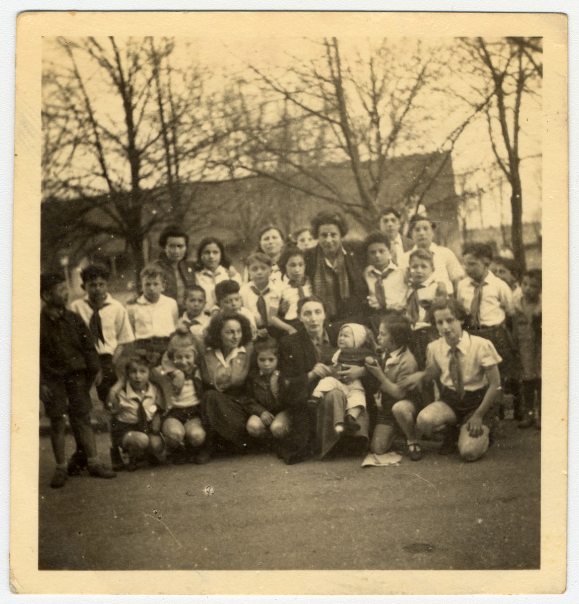 Group portrait of children in an orphanage in Israel.  Among those pictured is Sala Perec (front row, far right).