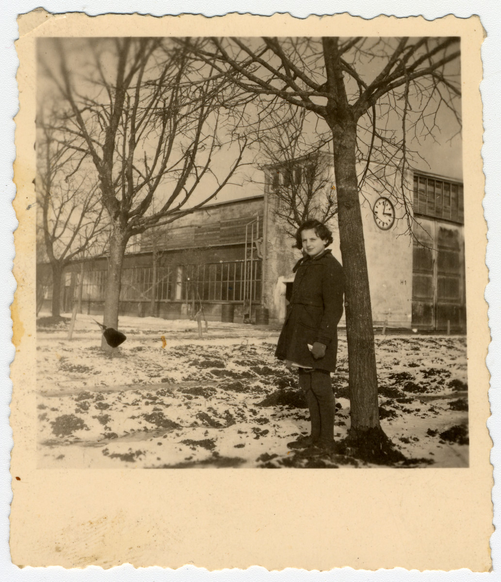 Sala Perec, a young Polish Jewish survivor, stands next to a tree outside the children's home in Dornstadt.