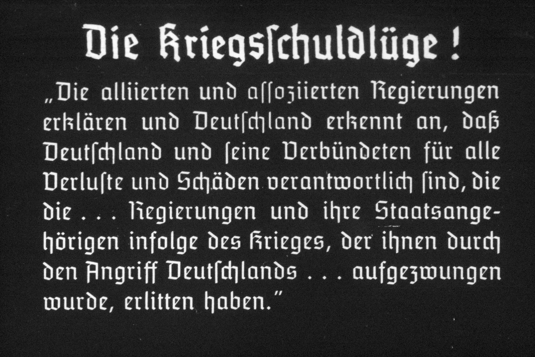 """33th slide from a Hitler Youth slideshow about the aftermath of WWI, Versailles, how it was overcome and the rise of Nazism. Die Kriegsschuldlüge  """"Die alliierten und assoziierten Regierungen erkl ä ren und Deutschland erkennt an, dass Deutschland und seine Verbündeten für alle Verluste und Schäden verantwortlich sind, die die...Regierunge und ihre Staatsangehörigen infolge des krieges, der ihnen durch den Angriff Deutschlands...aufgezwungen wurde, erlitten haben.""""  The war-guilt! """"The  Allied and Associated Government are explaining and Germany accepts that Germany and its allies are responsible for any loss or damage caused by the ... Government and its nationals as a result of the War, which was forced on them by the aggression of Germany ... have suffered. """""""