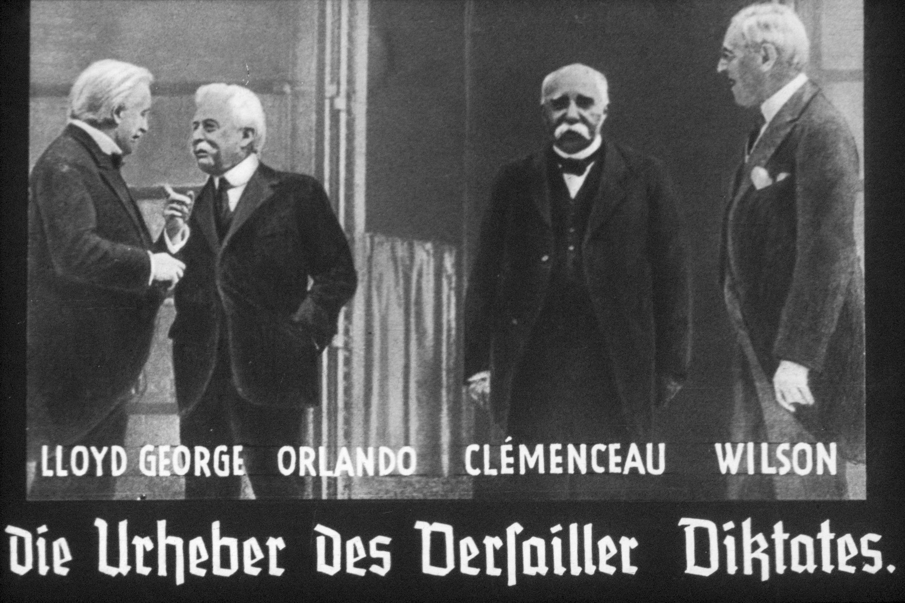 33th slide from a Hitler Youth slideshow about the aftermath of WWI, Versailles, how it was overcome and the rise of Nazism.  Lloyd George Orlando Cemenceau Wilson-Die Urheber des Versailler Diktates. // Lloyd George Orlando Cemenceau Wilson-The copyrighters) author of the Versailles Diktat.