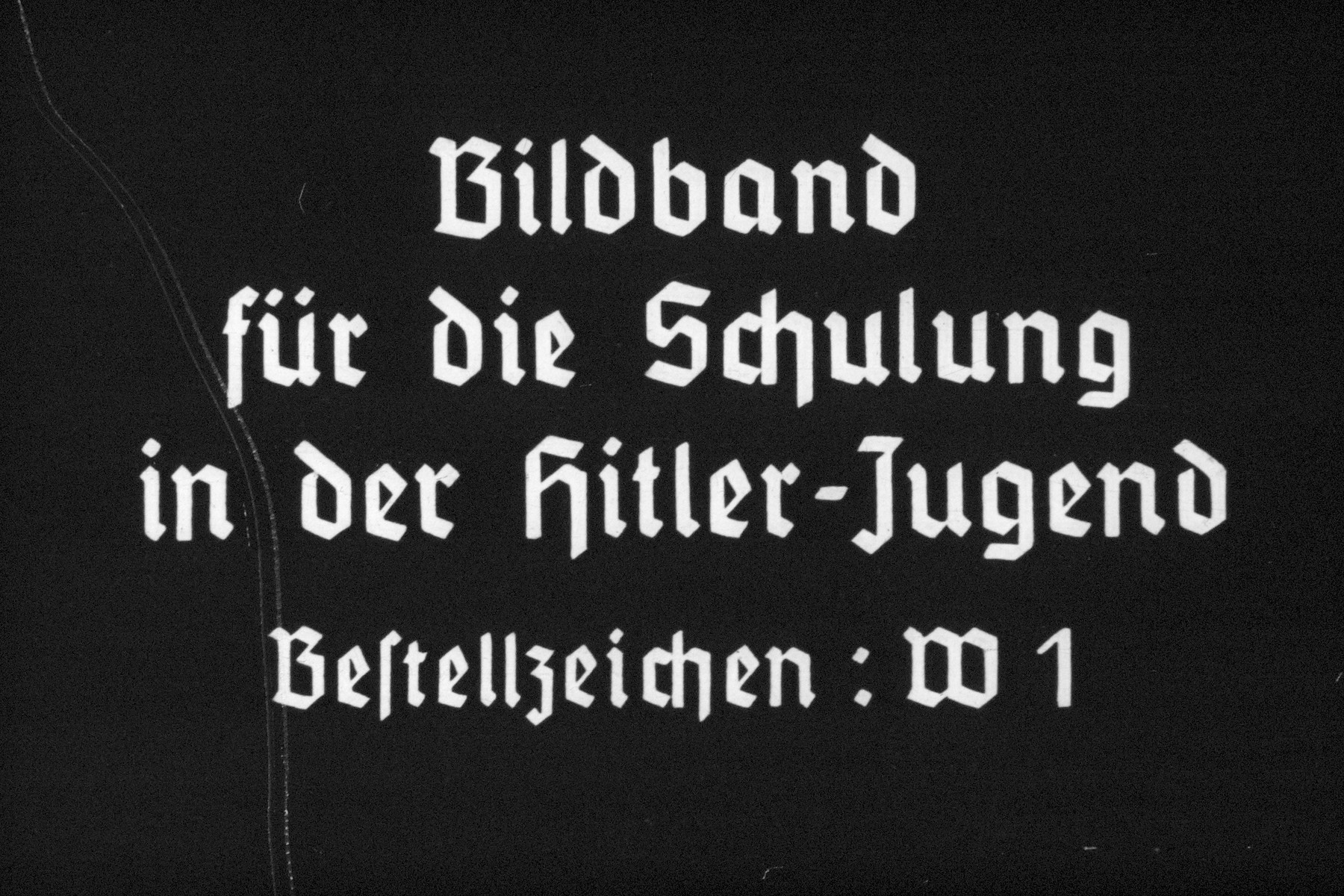38th slide from a Hitler Youth slideshow about the aftermath of WWI, Versailles, how it was overcome and the rise of Nazism.  Bildband fur die Schulung  der Hitler-Jugend Bestellzeichen: W1 Book for the training of the Hitler Youth Order code: W1