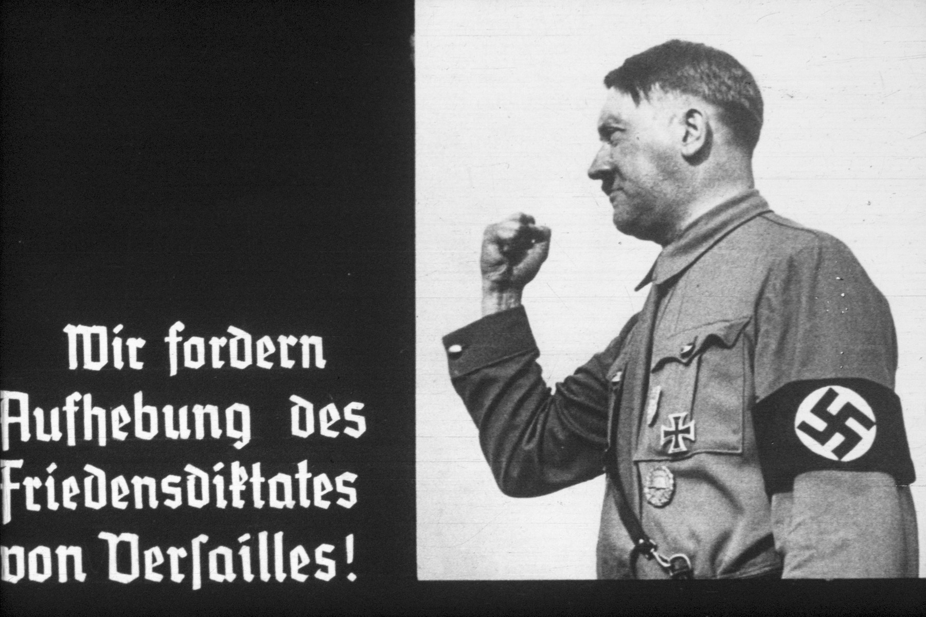 14th slide from a Hitler Youth slideshow about the aftermath of WWI, Versailles, how it was overcome and the rise of Nazism.  Wir forder Aufhebung des Friedensdiktates von Versailles! // We demand repeal of the Treaty of Versailles!