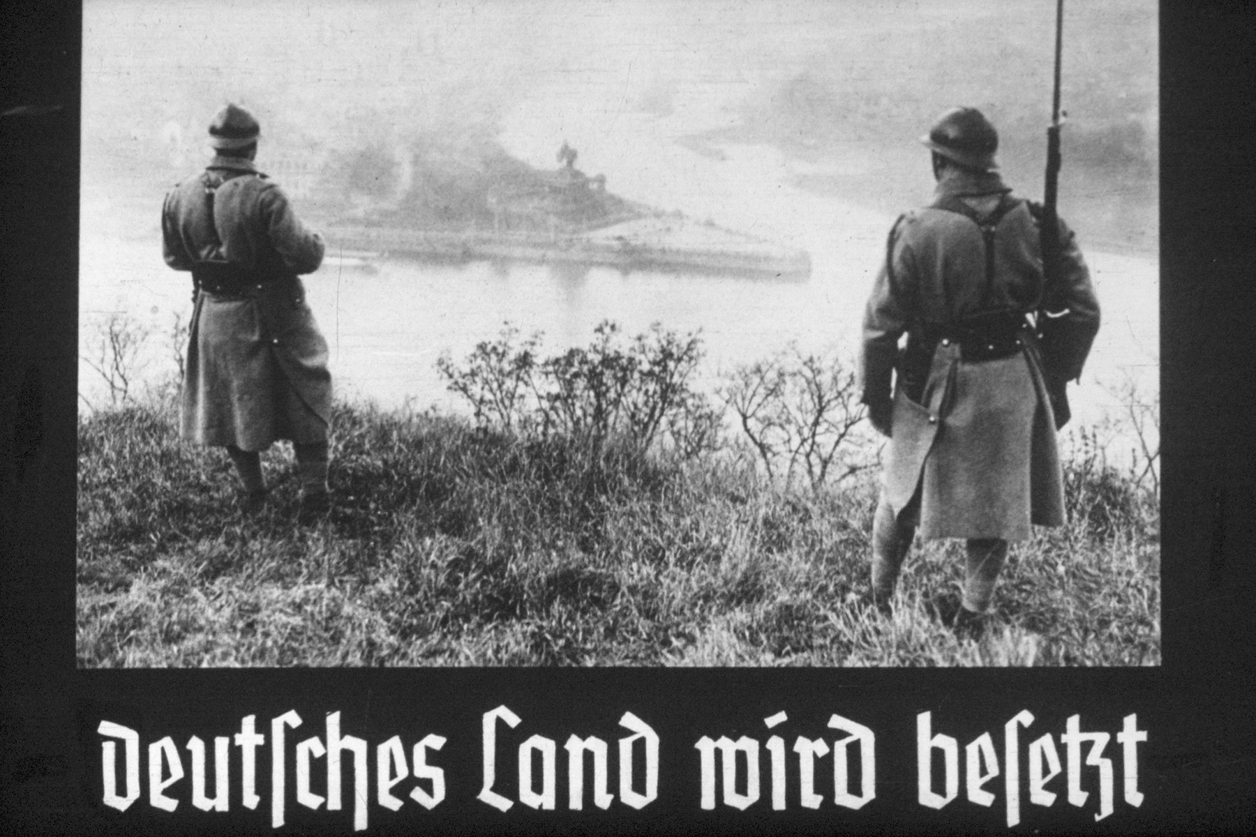 29th slide from a Hitler Youth slideshow about the aftermath of WWI, Versailles, how it was overcome and the rise of Nazism.  Deutsches Land wird besetzt. // German land is occupied.