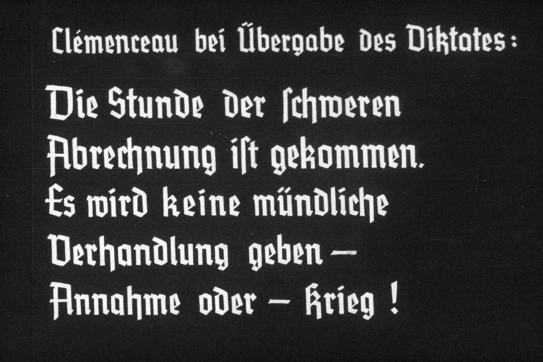 """34th slide from a Hitler Youth slideshow about the aftermath of WWI, Versailles, how it was overcome and the rise of Nazism.  Clemenceau bei ü bergabe des Diktates: Die Stunde der Schweren Abrechnung ist gekommen. Es wird keine mundliche Verhandlung geben--Annahme oder--krieg! // Clemenceau opening at the dictation:  """"The hour of reckoning has come heavy. There will be no oral hearing - acceptance or - war!"""""""