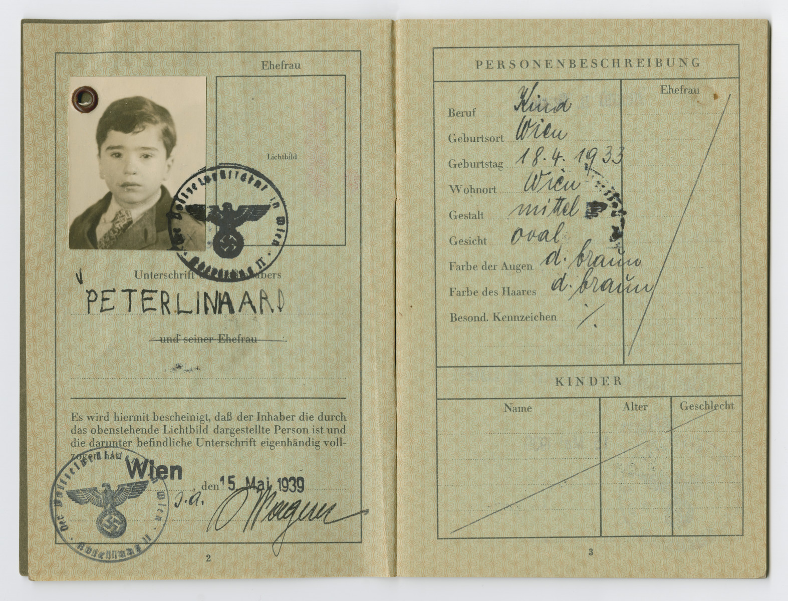 Identification papers issued to Peter Linhard stating he was born in Vienna on April 18, 1933.