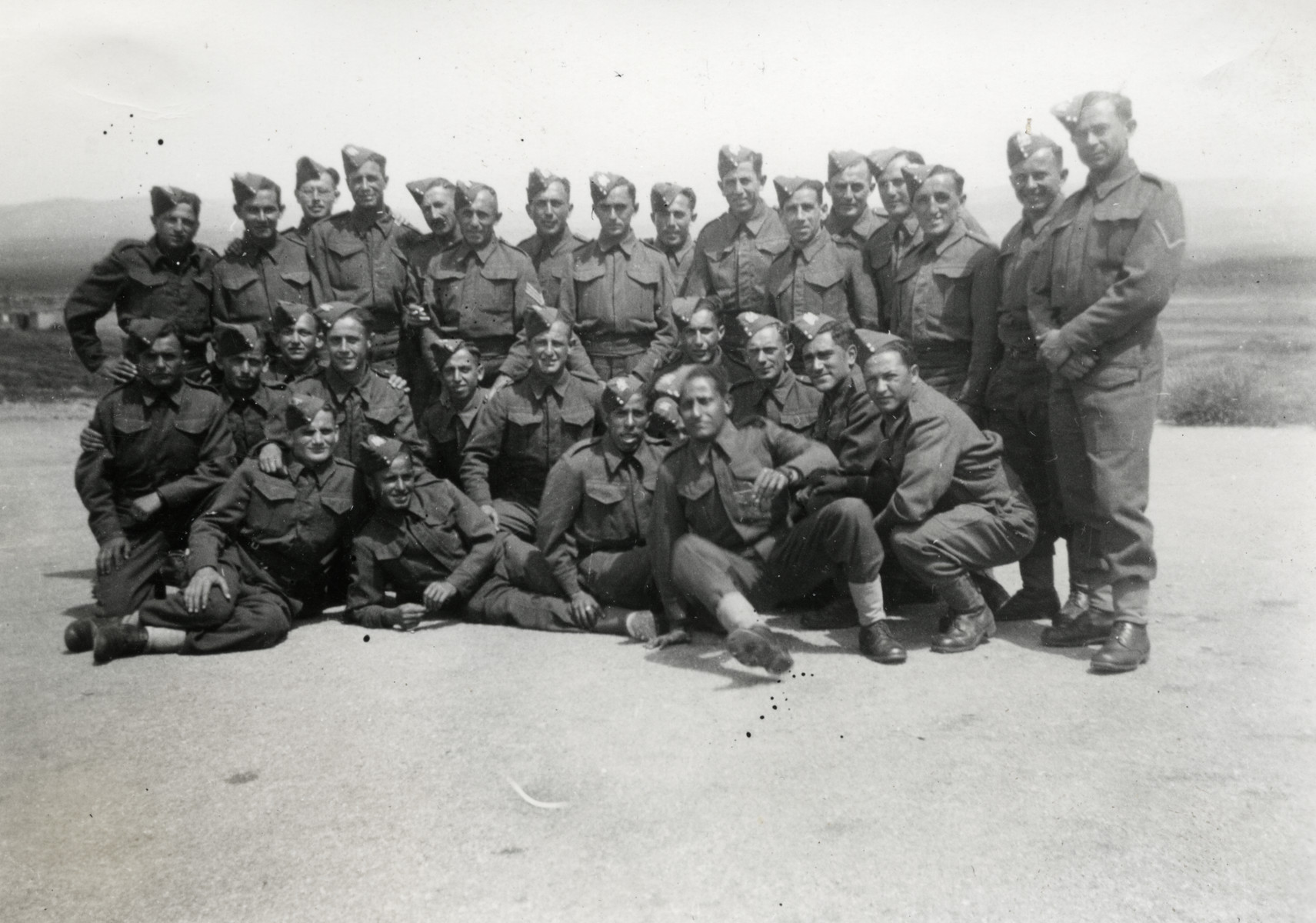Group portrait of Jewish Brigade soldiers (Unit 8) in Libya.  Chaim Leichter is located in the second row, third from the right.
