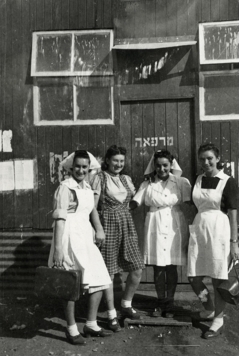 Four nurses stand outside a health clinic in a detention camp in Cyprus.  Sara Szajfman is standing on the left.
