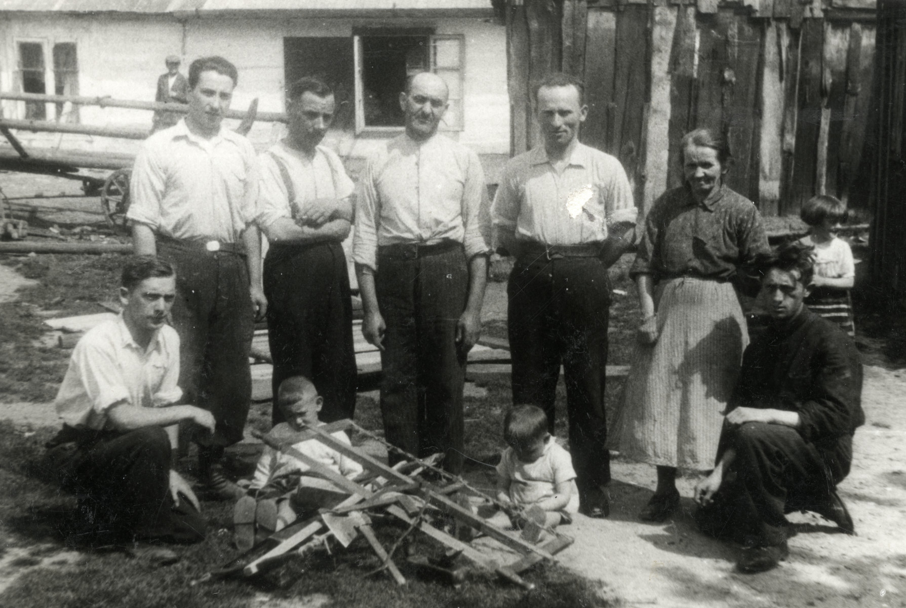Chaim Leichter (kneeling left) poses with other workers at a workshop where he is studying carpentry.