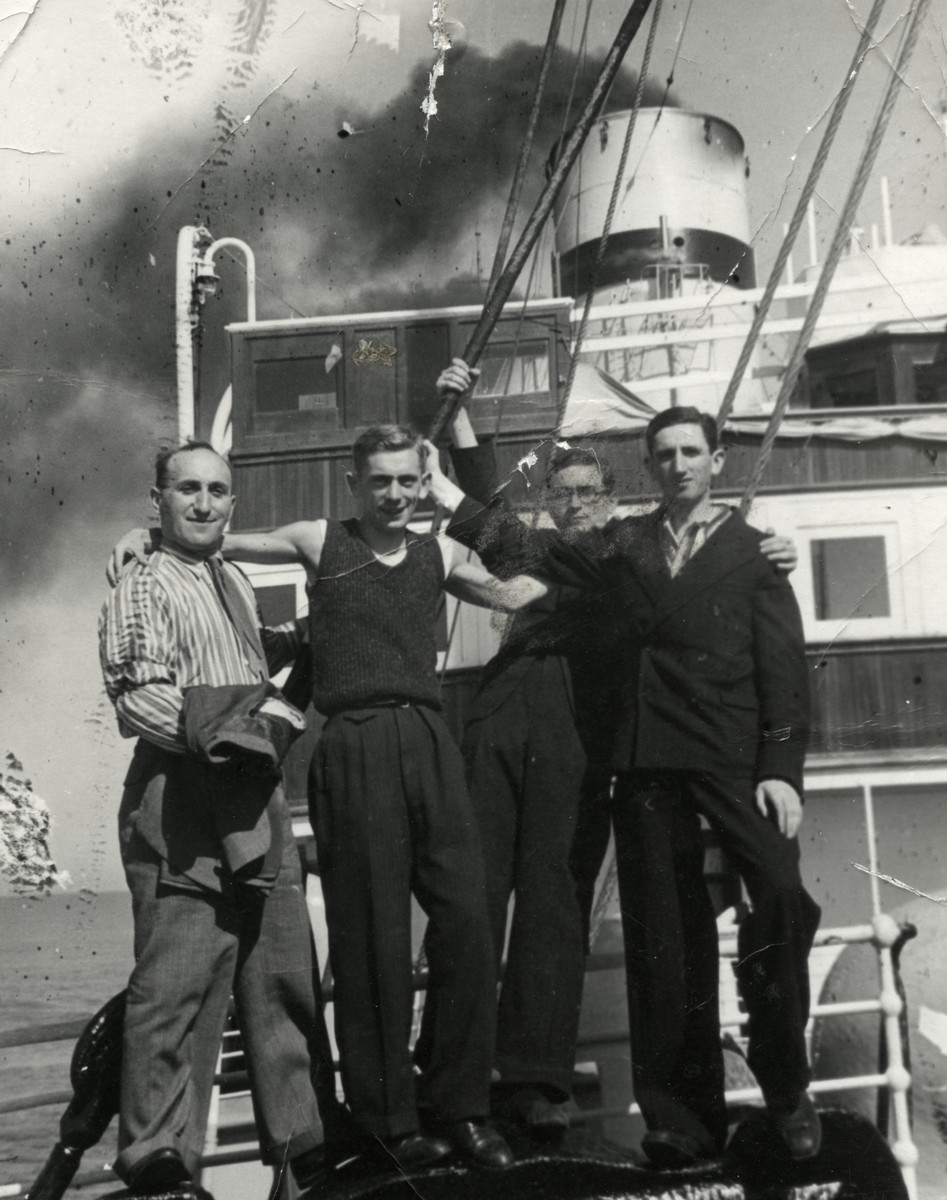 "Four young Zionists gather on the deck on the ""Polonia"" en route to Palestine.  Chaim Leichter is pictured second from the left.  Zacharya Osharowski is standing on the far right."