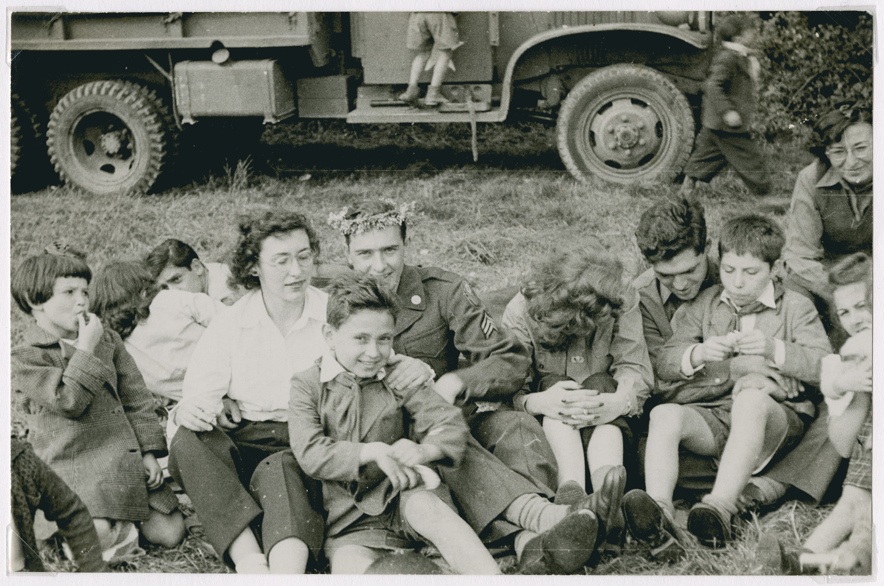 Members of the Frankfurt GI Council go on an excursion with children [probably from the Lindenfels children's home].  David Marcus is seated on the right, looking down.