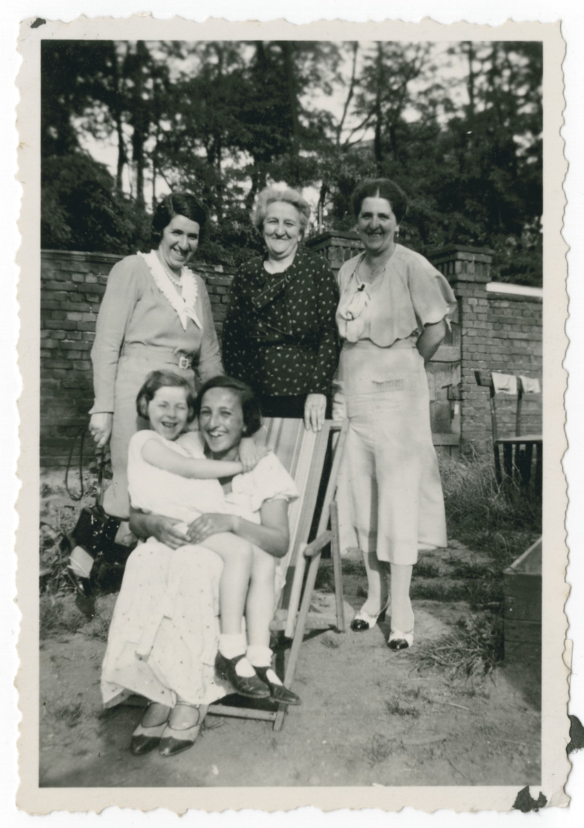 Family portrait of three generations of Weissblum women.            Selma Weissblum is standing in the back flanked by her daughters Erna Pikarski (left) and Julia Schleyer, (right). In front is Julia's daughter Inge sitting on the lap of Fanny Brass.(All of them later lived in California).