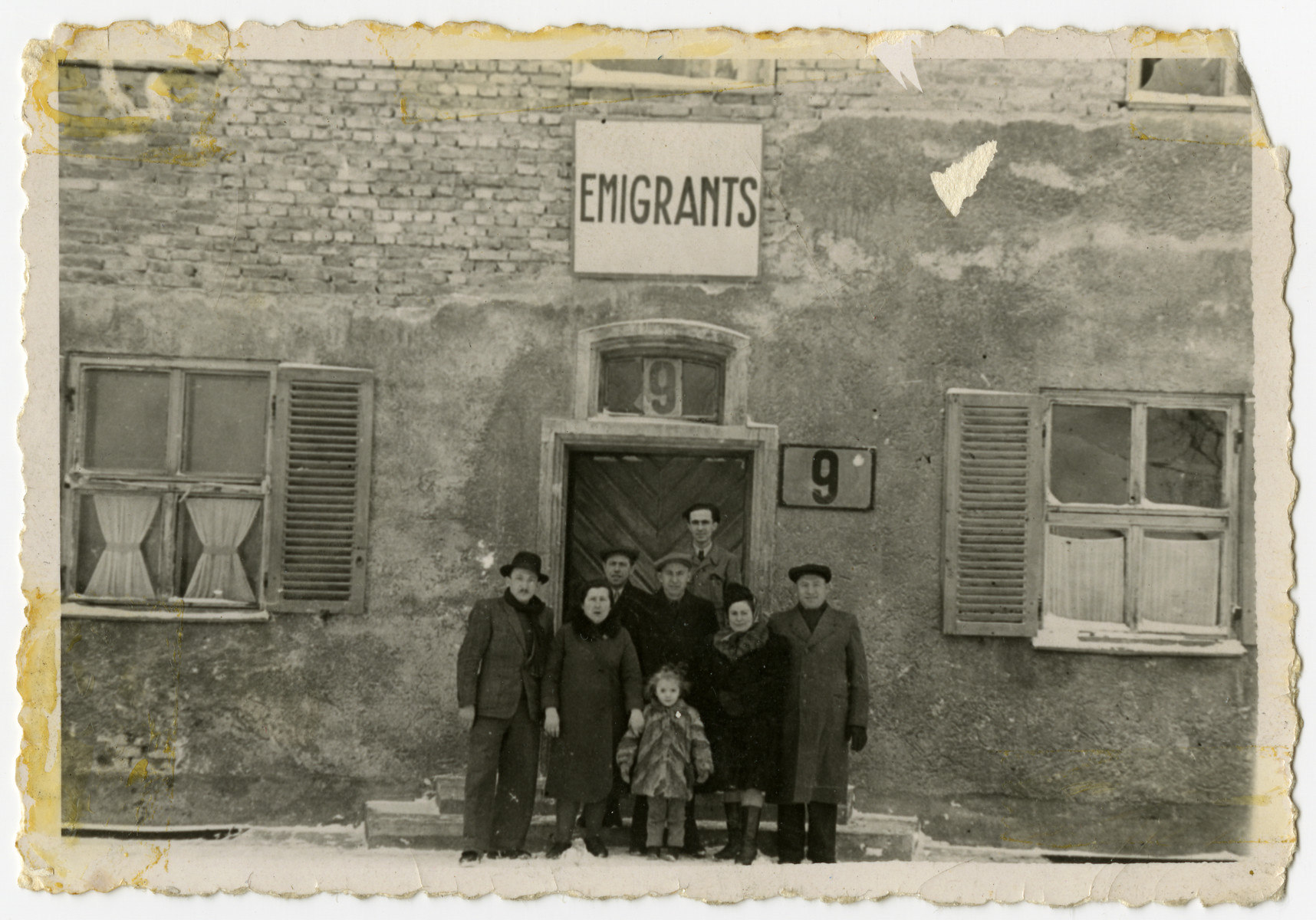 Jewish displaced persons pose in front of the emigration office in Bamberg.  From left to right in the front are Solomon, Ruchla and Frieda Zynstein.