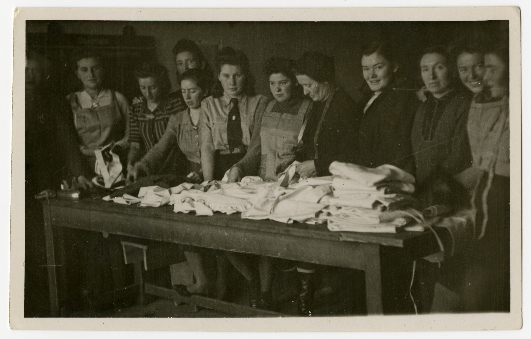 Women sort linens in the Bamberg displaced persons camp.