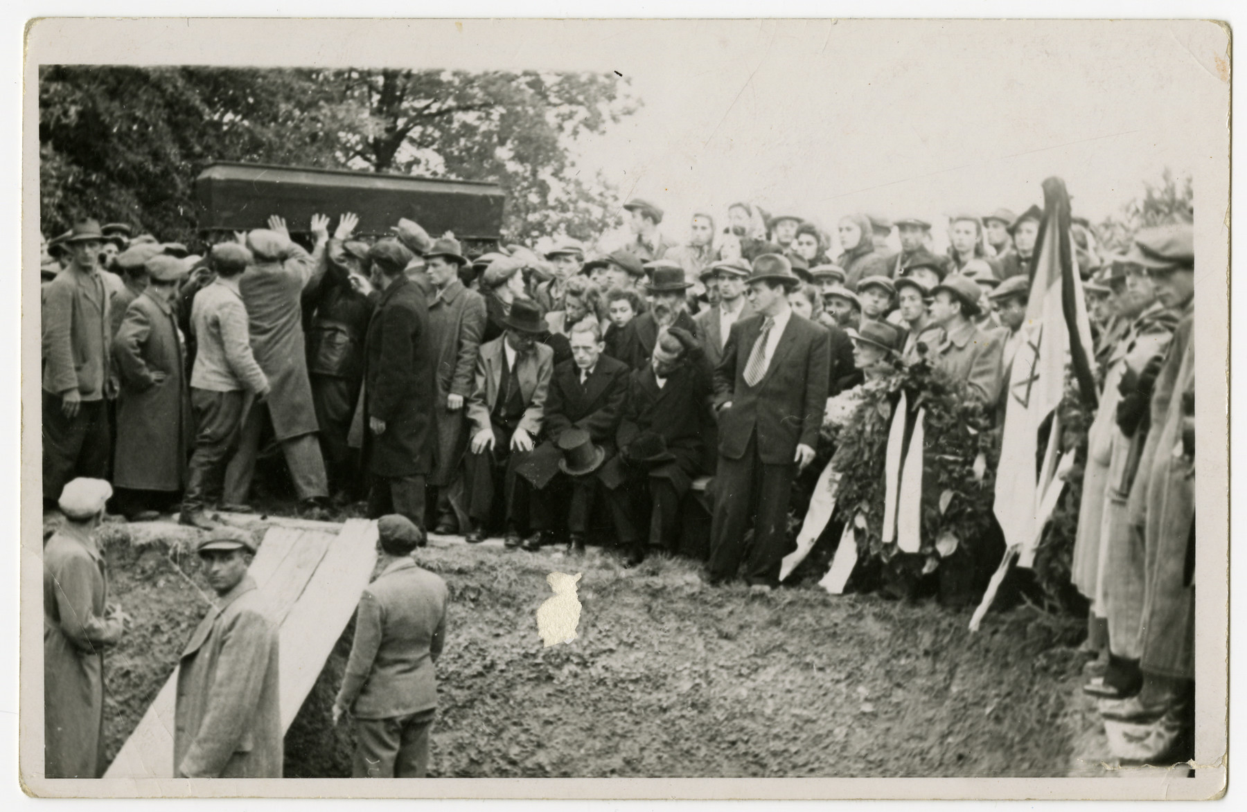Displaced persons gather for a funeral.