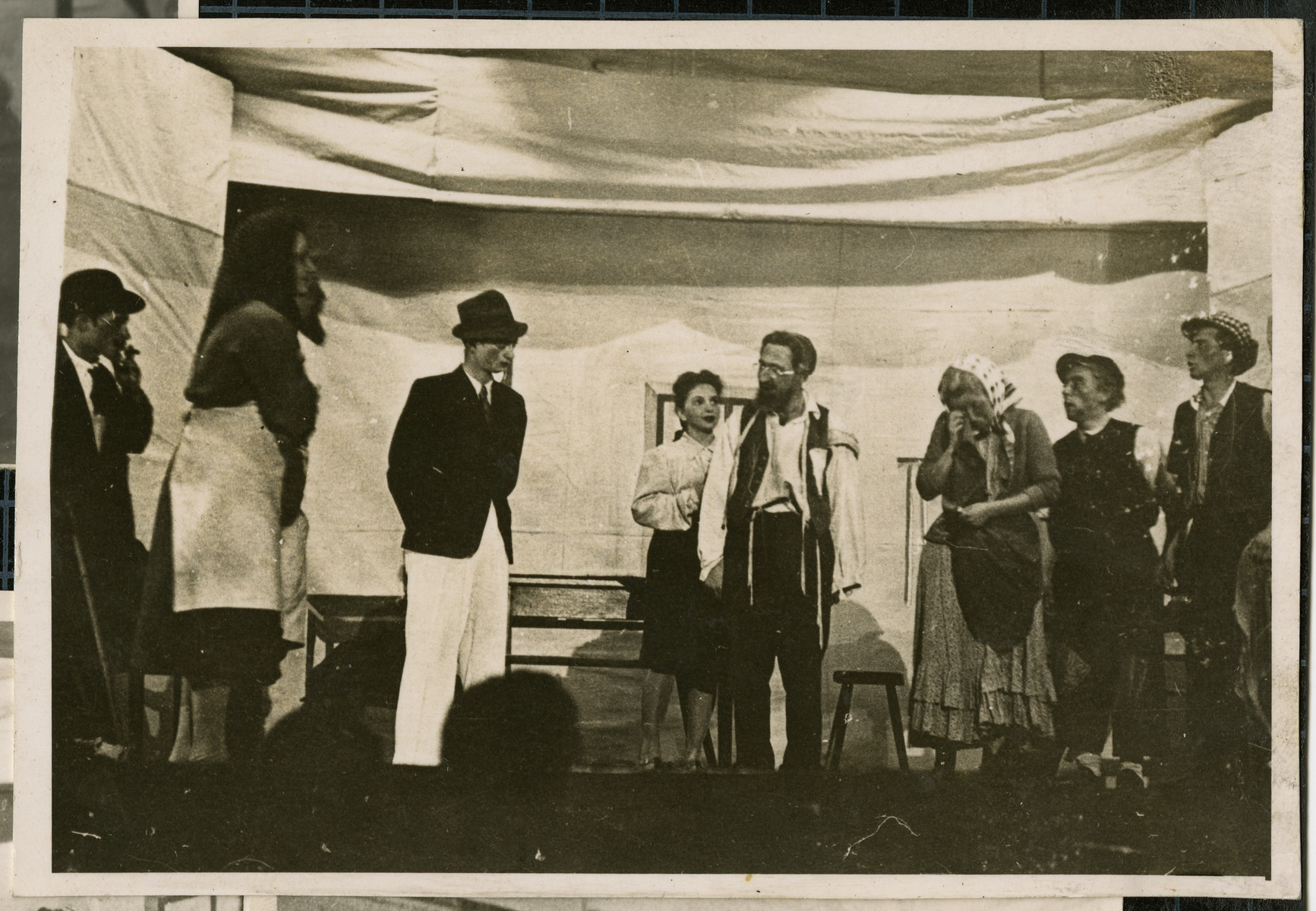 The theater troupe in the Bamberg displaced persons camp performs Sholom Aleichem's Die Grosse Genvinz, directed by Solomon Zynstein.