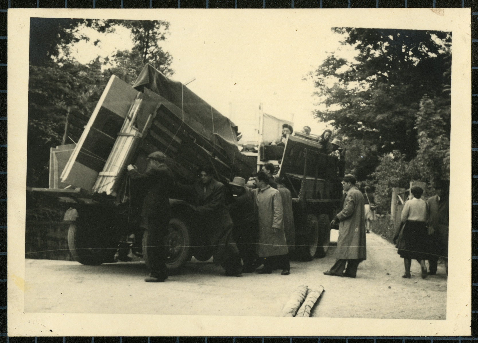 Members of the Bamberg Yiddish Theater group load a truck with props as they prepare to perform a play in a neighboring displaced persons camp.