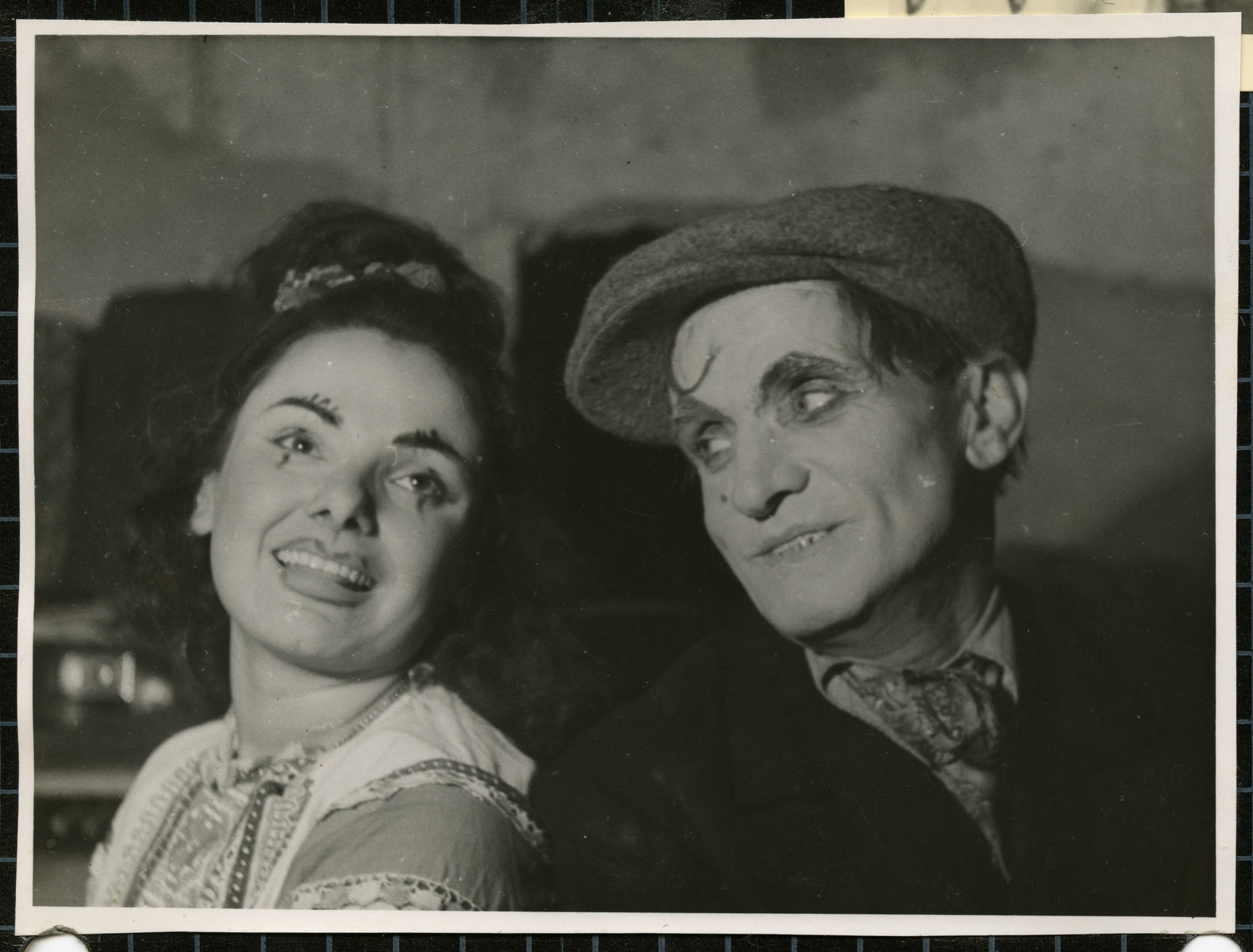 Close-up portrait of a male and female actor in the Bamberg Yiddish theater troupe.