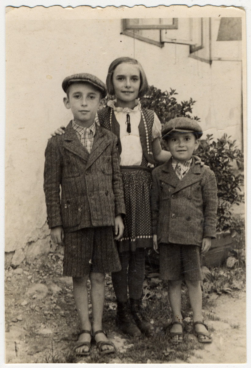 Prewar family portrait of Malchi Deutsch (nee Davidovich), cousins of Rose Dratler.  Pictured are Malchi Deutsch and her three children, Suri, Ari and Mendi.  This is one photograph from the album of Rosalia Dratler Roiter.  She later was deported to and perished at Auschwitz.