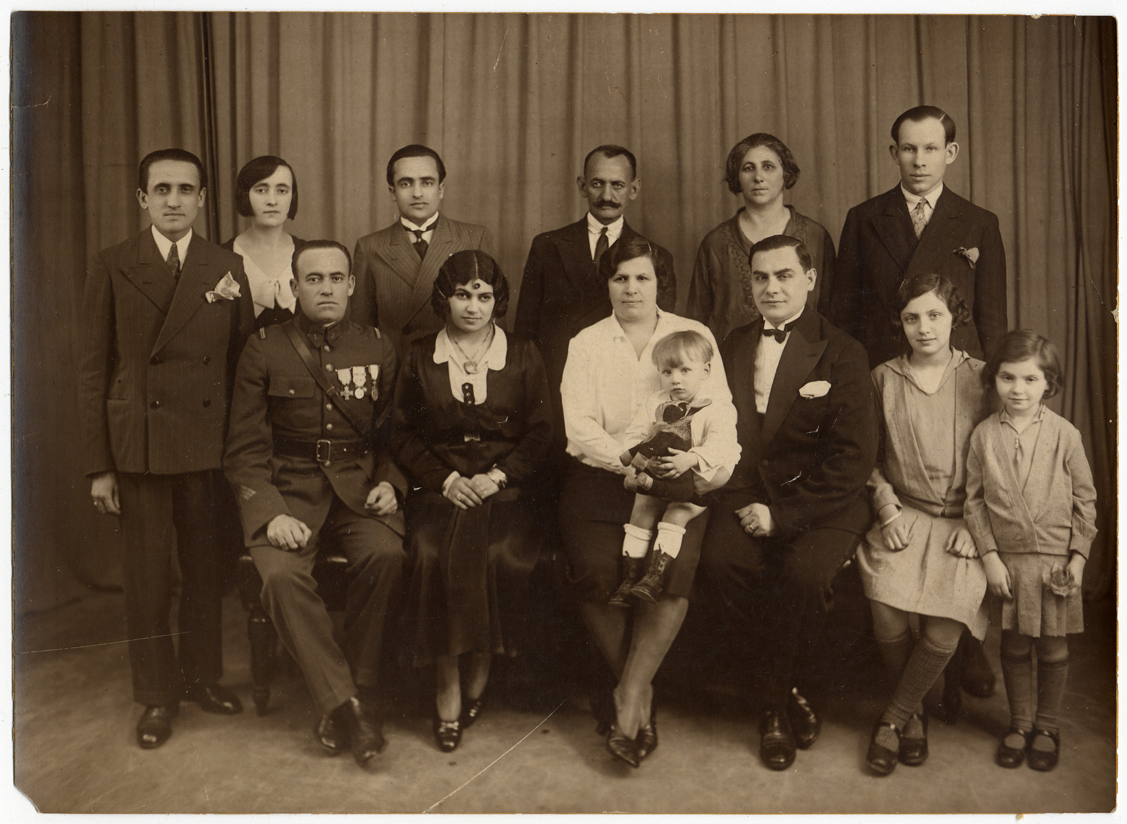 Prewar family photograph of the Roiter family.    Philip Roiter is standing third from the left.  His uncle is next to him.  This is one photograph from the album of Rosalia Dratler Roiter.  She later was deported to and perished at Auschwitz.