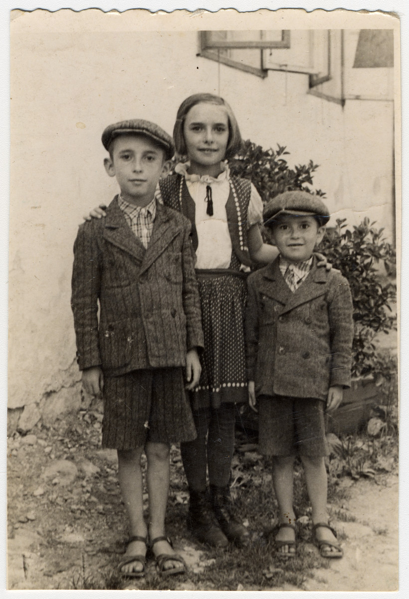 Prewar family portrait of the Deutsch family in Sighet, cousins of Rose Dratler.  Pictured Suri, Ari and Mendi Deutsch.  This is one photograph from the album of Rosalia Dratler Roiter.  She later was deported to and perished at Auschwitz.