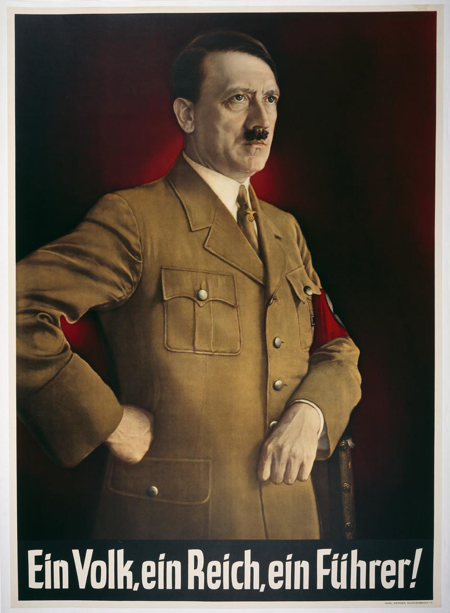 """Poster of Hitler standing with the headline """"Ein Volk, ein Reich, ein Fuehrer"""" (One People, one Reich, one Fuehrer!)."""