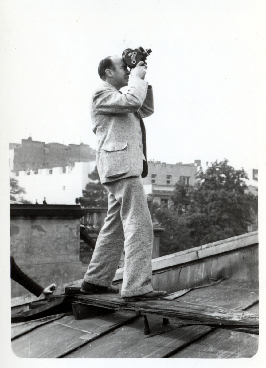 "Julien Bryan films German planes on the roof of the American Consulate.  He writes in Siege: ""Toward the end of the siege I was on the roof of the embassy....It was so exciting and thrilling that I quite forgot my fear. During the next half-hour I took three hundred feet of film as Nazi planes dove down within a few hundred yards of the embassy roof, seeming, through my view finder, to be almost upon me."""