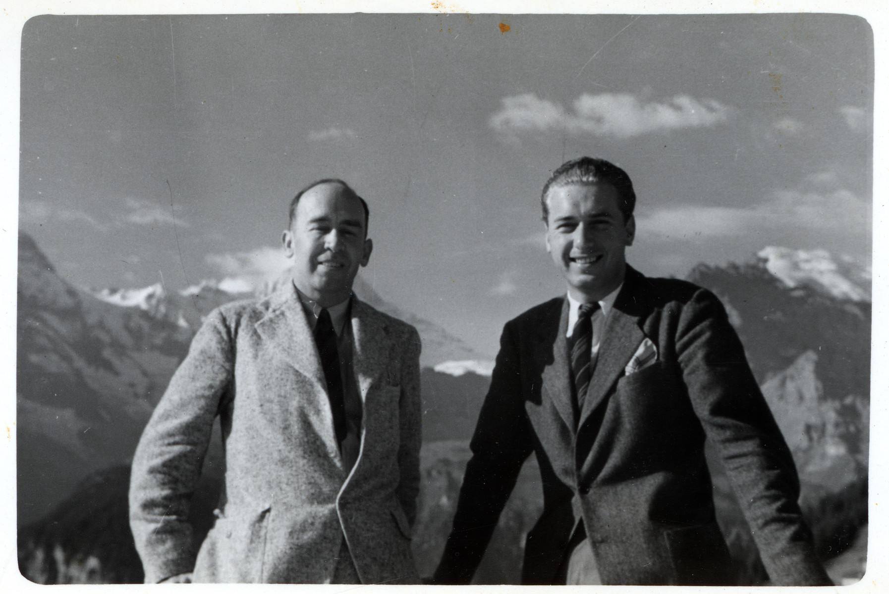 Julien Bryan poses with another man in an unknown location [the Alps may be in the background].