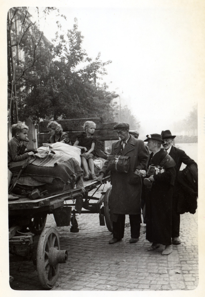 A Polish family flees the beiseged city of Warsaw on a wagon.