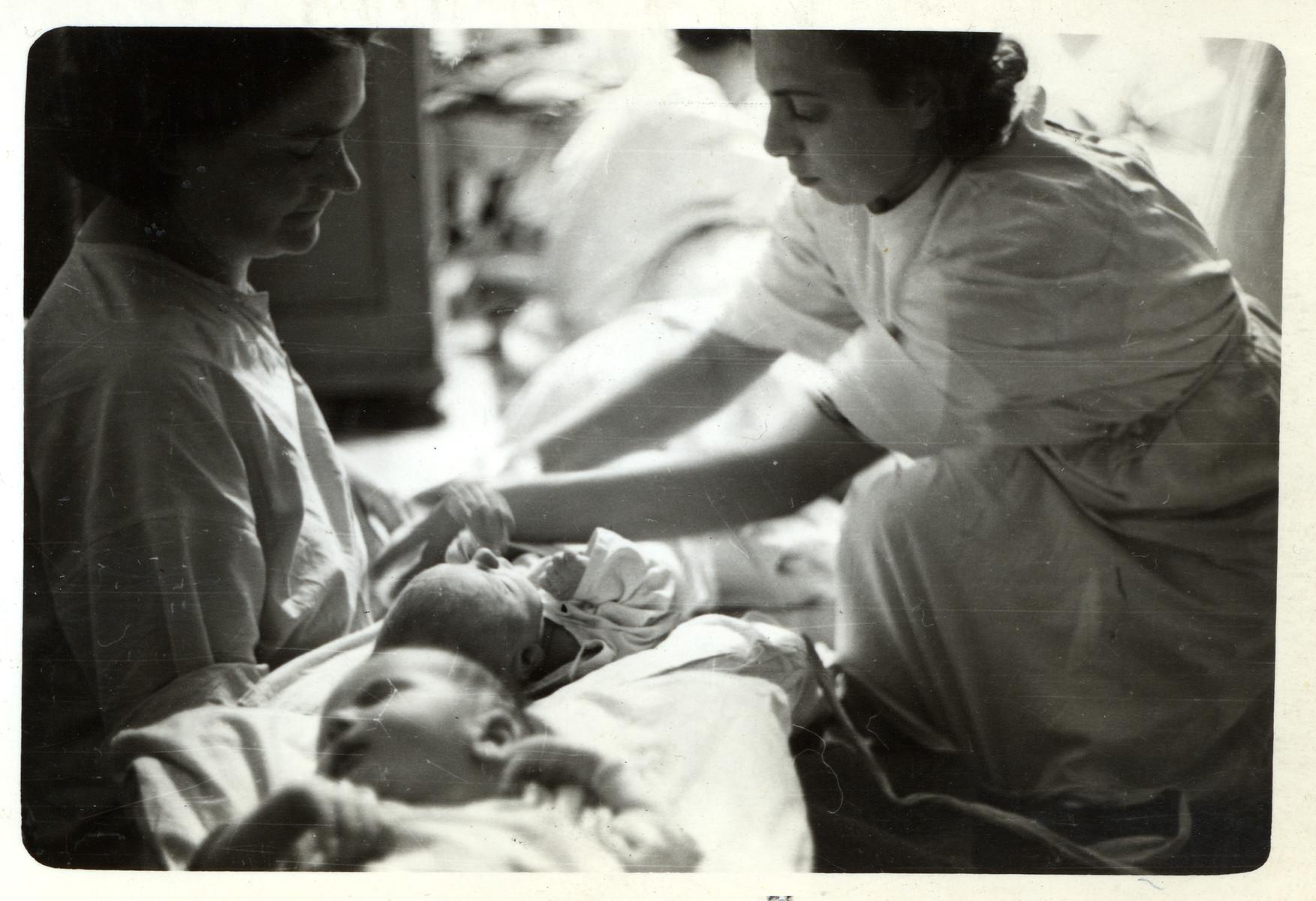 Nurses tend to newborn babies in a makeshift maternity ward in besieged Warsaw.