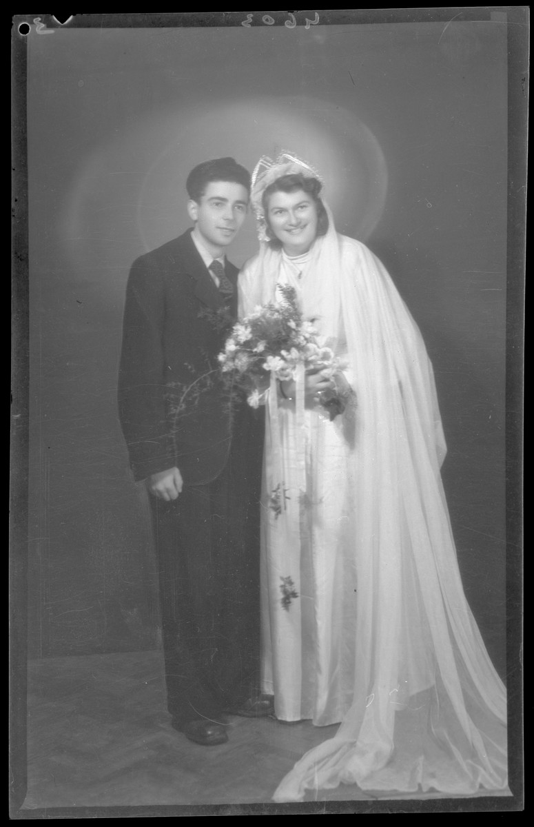 Studio wedding portrait of Herman Fischer and his bride.