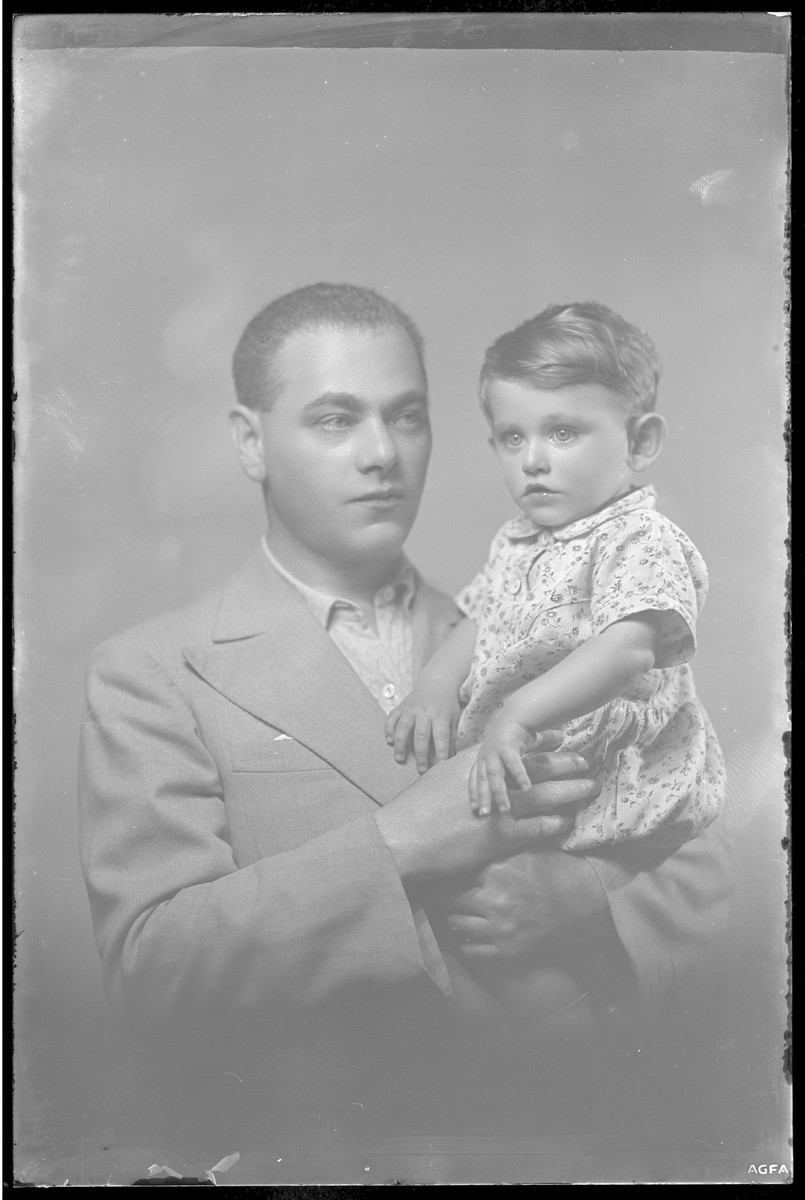 Studio portrait of Dr. Foldes and his child.