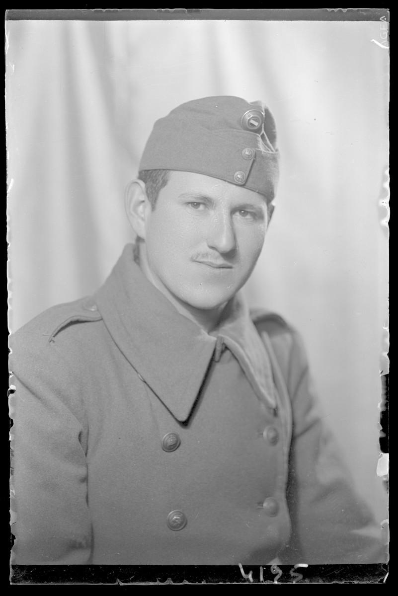 Studio portrait of  Bela Fischer in a military uniform.