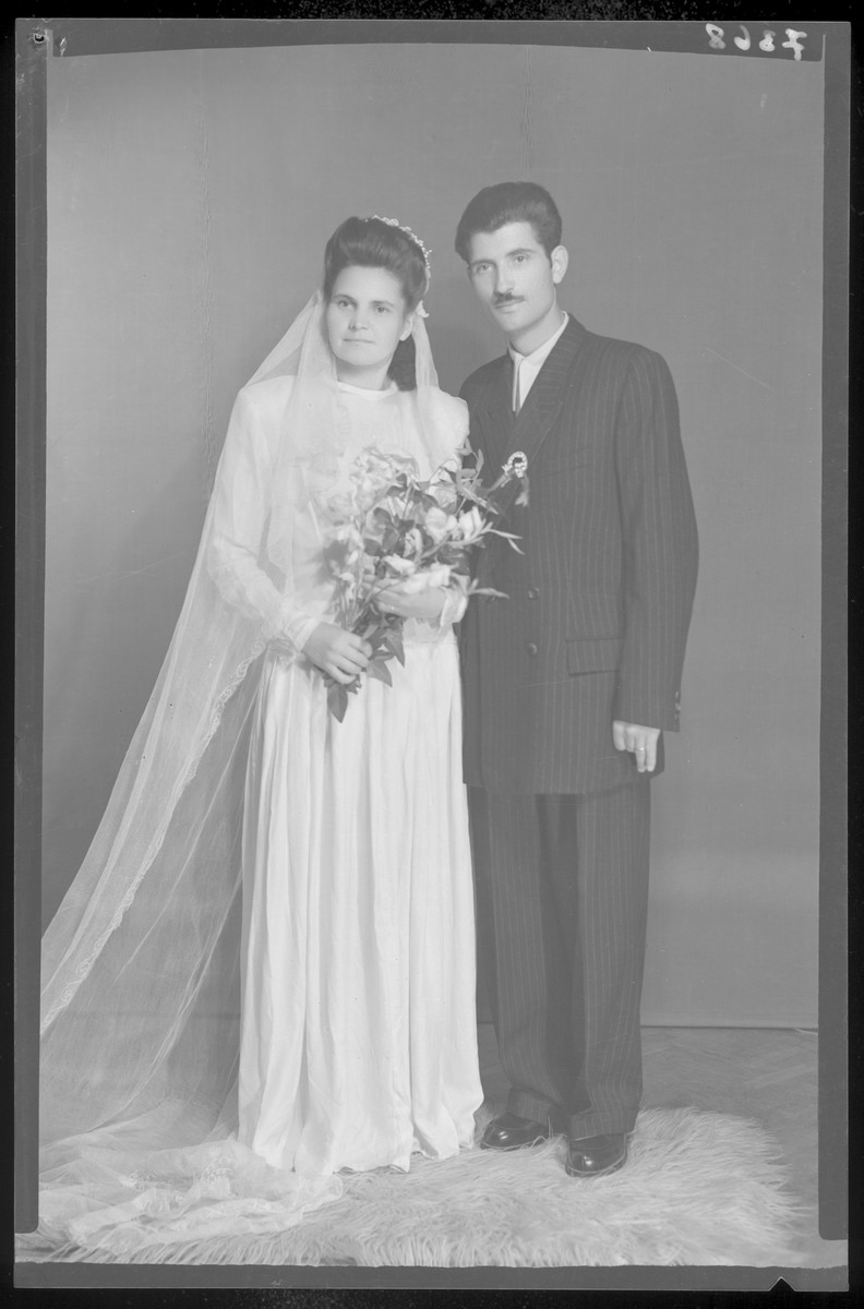Studio wedding portrait of an unidentified couple.