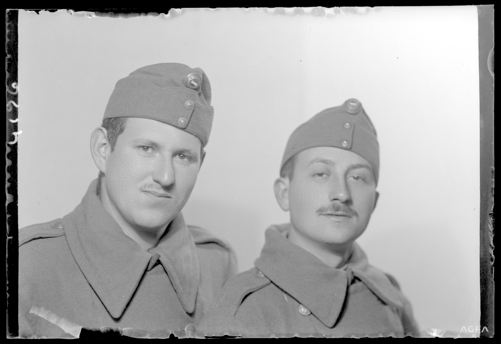 Studio portrait of Bela Fischer in a military uniform with another soldier.