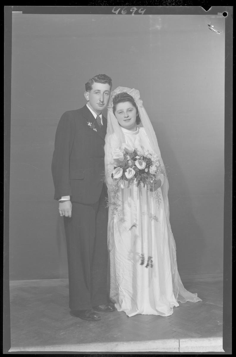 Studio wedding portrait of Antal Fogel and his bride.