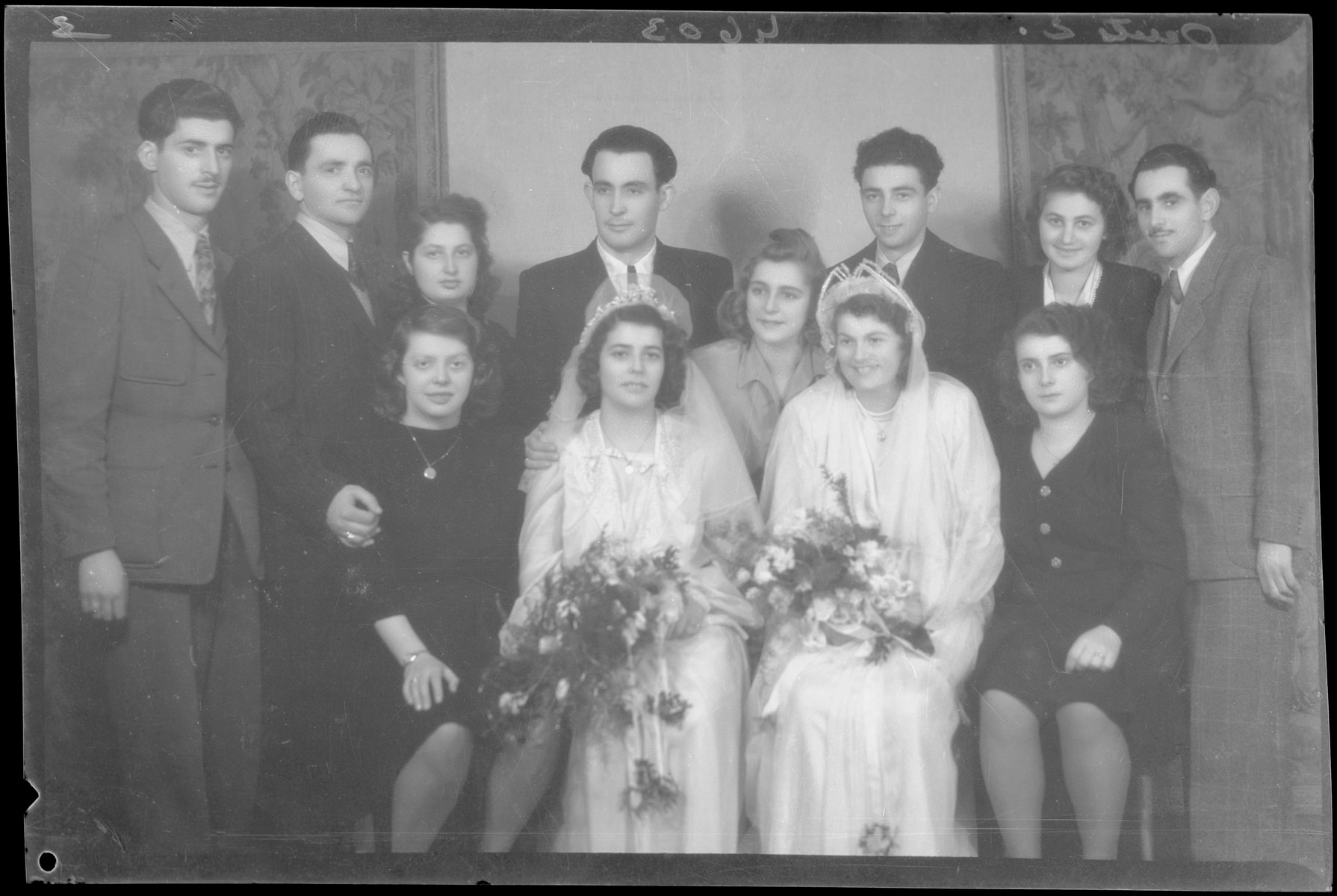 Studio portrait of the wedding of Herman Fischer together with that of another wedding.