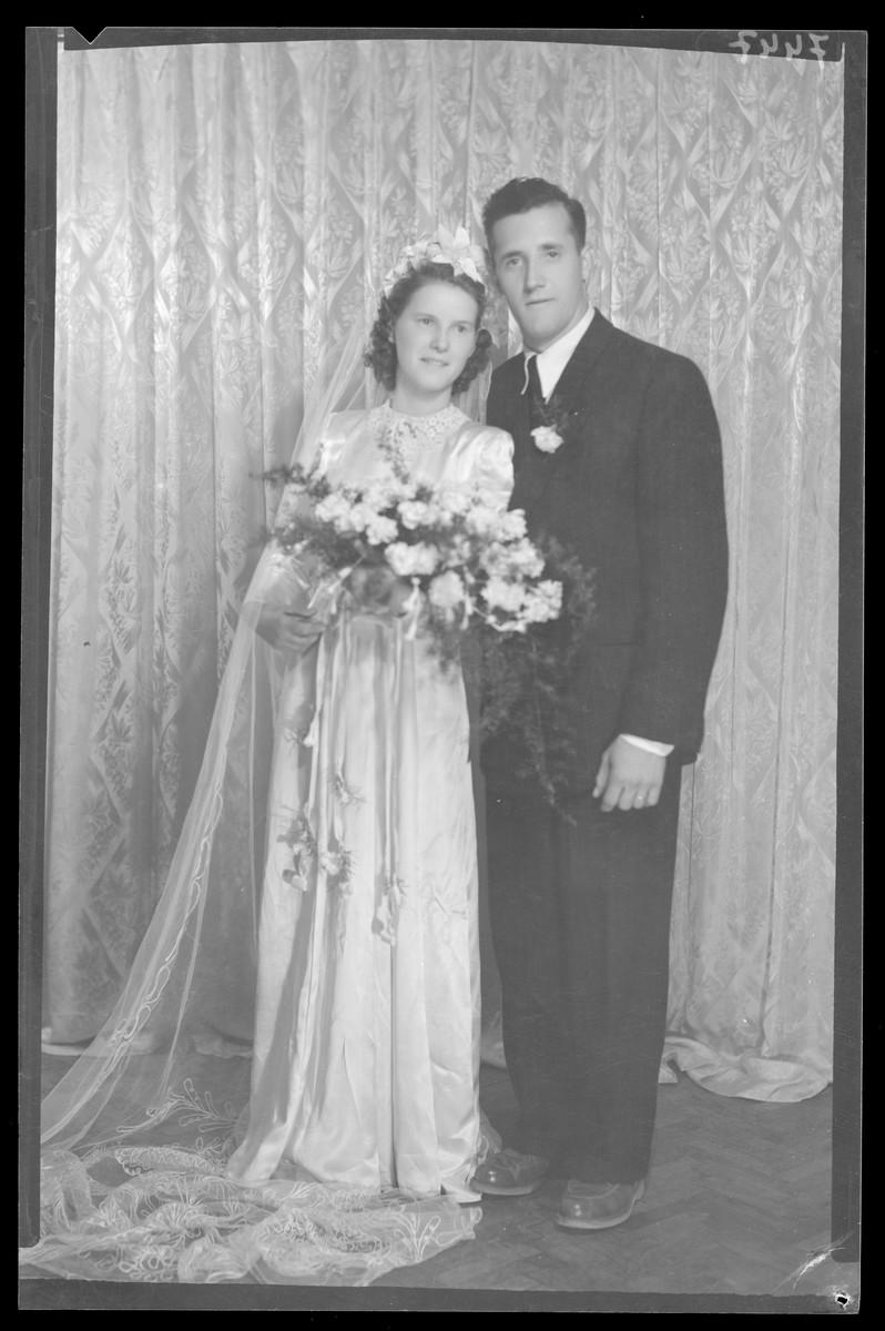 Studio wedding portrait of an unidentified couple.