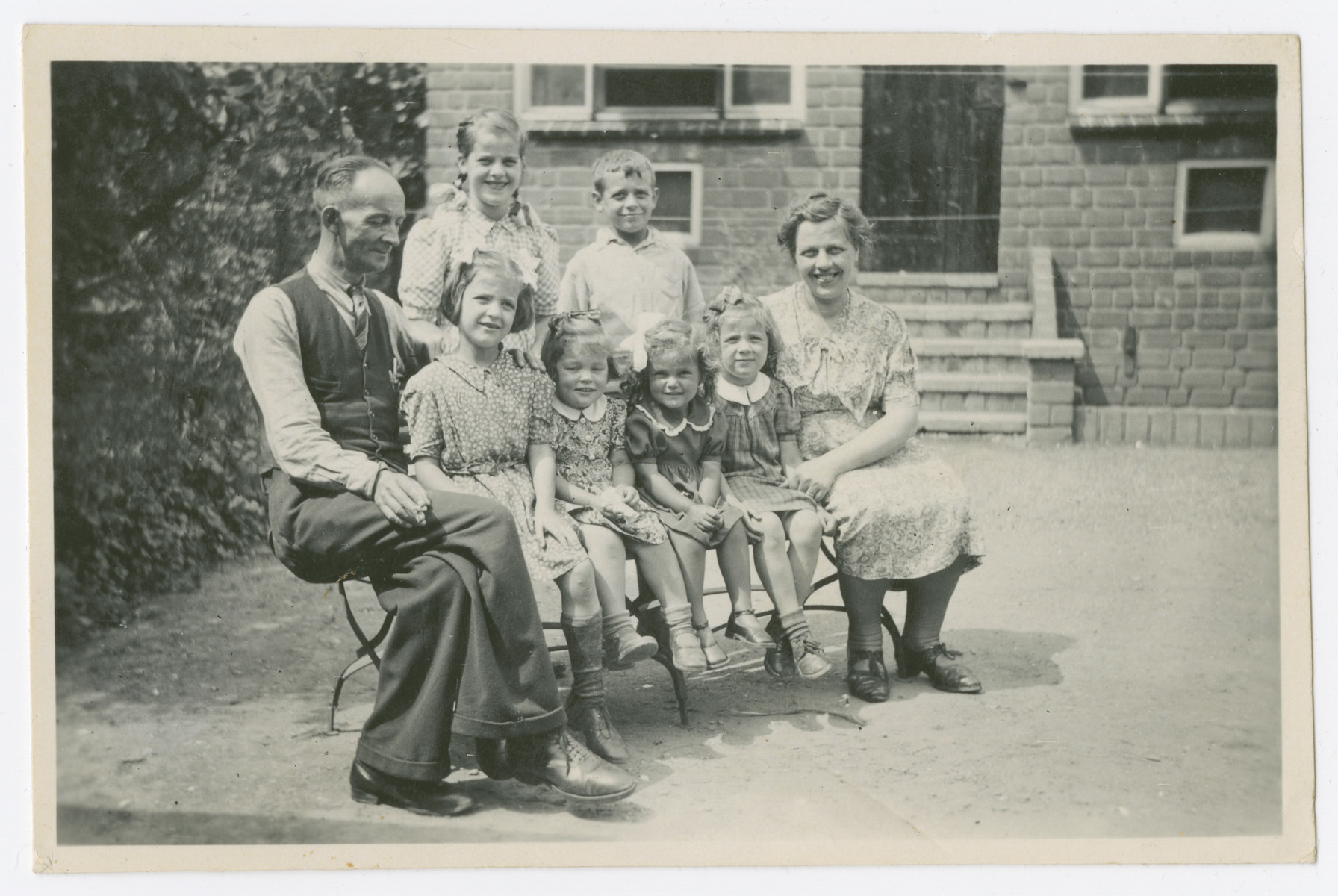 Ineke Baars (front center) visits the family of Cor van Doorn, a Dutch official who assisted Frans Wijnakker's rescue effort.