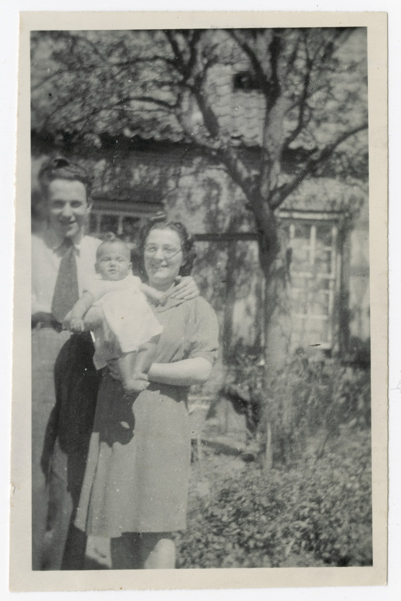 Louis and Engelien Baars pose outside with their infant daughter Ineke soon after their liberation.