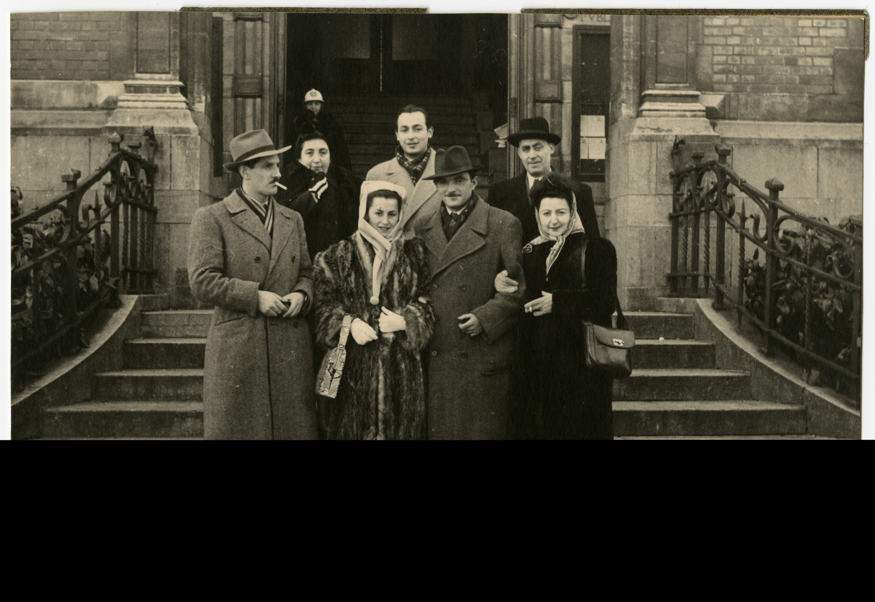 Group portrait of Belgian Zionists after the war standing on the steps of a building.  Fela Perelman is standing at the front, right.  Willy Katz is at the front, left.